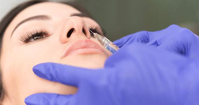 Closeup cropped image of new modern noninvasive procedure of rhinoplasty on female patient, Aesthetic corrective treatments concept